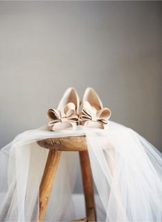 nude shoes with a lower heel. Not especially excited about the size of the bows...