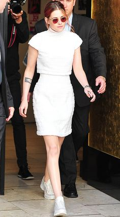 "Kristen Stewart wears head-to-toe Chanel Spring 2014 Haute Couture with a Chanel Première Triple Row watch while doing press for ""Clouds of Sils Maria"" during the 2014 Cannes Film Festival."