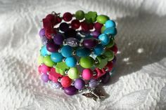 Unique rainbow memory bracelet made with resin beads acrylic beads m tallic beads rubber beads metal memory wire You just have wrap it around your wrist If you want eargins Bracelet Making, Jewelry Making, Babysitter Gifts, Gifts For Women, Gifts For Her, Gifts For Colleagues, Wire Necklace, Christmas Gift Guide, Last Minute Gifts