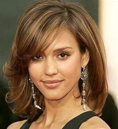 Medium length haircut with side sweeping bangs