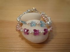 Handmade Kids' Baby Pink or Baby Blue Freshwater Pearls Bracelet with Swarovski Crystal Butterflies by urbaneprincess on Etsy