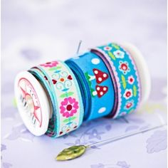 Store ribbons on empty cotton spools - full article on Craft and Creativity blog