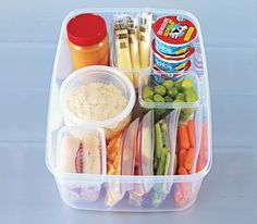 Refrigerator Grab-and-Go Snack Station by RealSimple: Stock it with: Jar of peanut butter (preferably the natural kind, for dipping); String cheese; Yogurt; Grapes; Assorted crudités - baby carrots, celery sticks, pepper slices - in plastic bags; Orange segments; Lunch-meat roll-ups (like turkey-and-Swiss or ham-and-cheddar); Tub of hummus (for dipping). #Snack_Station #Refrigerator #Healthy