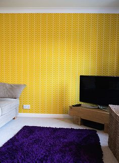 Purple and Mustard Living Room. Orla Kiely wallpaper.