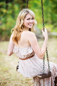 Creative High School Senior portrait photography on a swing, by photographer Charleton Churchill.