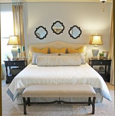 Boldness of Color - Canary Yellow: The yellow pillows are great, but what I really love is the fabric on the upholstered headboard and bolster pillow. The little yellow accents in the pattern tie in perfectly. And the light blue is a great choice to go with it!