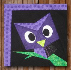 "Easy Peeping Owl is a 10"" x 12"" paper pieced quilt pattern, and is a part of the Peeping Critters Pattern Collection.    She doubles as a Halloween pattern too! Ah, that's the magic of fabric eh?"
