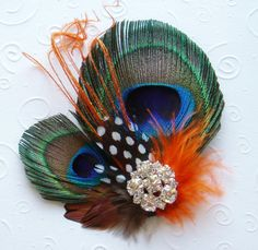 Wedding Hair Clip Bridal Peacock Feather Fascinator orange brown fall autumn. $31.00, via Etsy.