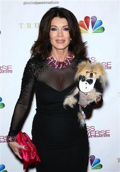 Lisa Vanderpump and her dog Giggy arrive at the Miss Universe 2012 finals at Planet Hollywood Resort in Las Vegas on Dec. 19, 2012. See more celebs on Wonderwall: http://on-msn.com/U4JegD