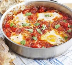 Spicy tomato baked eggs. So much flavour to this simple tomato sauce... add what ever you have to hand and a couple of eggs. Pop in the oven and enjoy!