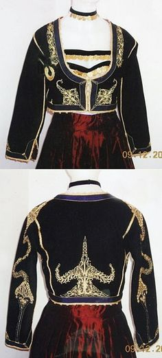 Close-up of a traditional festive costume from Crete.  Greek, early 20th century. Jewels with gold coins, and embroidered long-sleeved jacket.