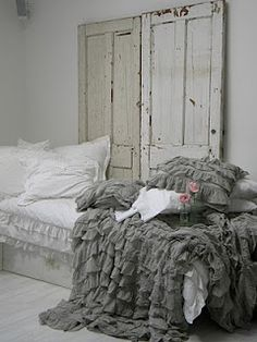 grey duvet cover used as bedspread from urban outfitters