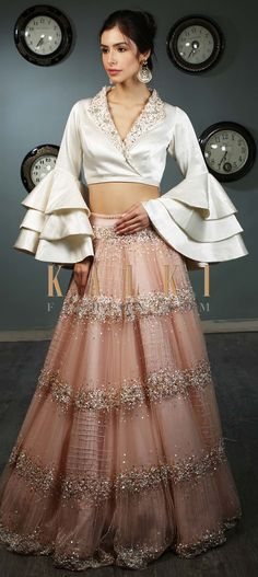 White Blouse In Satin With Layered Frill Sleeves Paired With Peach Net Skirt In Moti And Sequins Embroidery Online - Kalki Fashion Indian Gowns Dresses, Indian Fashion Dresses, Dress Indian Style, Indian Designer Outfits, Fashion Outfits, Net Dresses, Blouse En Satin, Frill Blouse, Frill Dress