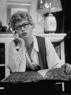 SHELLEY WINTERS, POSING OVER A DICTIONARY