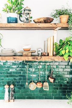 A bright blacksplash is the perfect way to give your kitchen a seasonal feel. Add simple greenery and copper touches for a look that's nothing short of fresh. Via The Jungalow