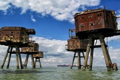 The Maunsell Sea Forts designed by Guy Maunsell were fortified towers built in 1942 in the Thames and Mersey estuaries to provide anti-aircraft fire. They were arranged with the control tower in the center, the bofors and gun towers in a semicircle and the search light further away.