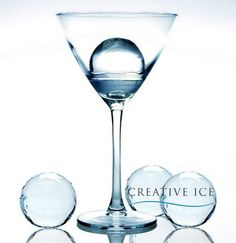 Cocktail ice spheres in a martini glass. Chill your gin without watering it down.