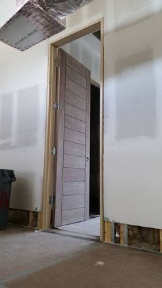 8 And 9 Tall Trustile Trumodern Doors In Walnut Being Installed