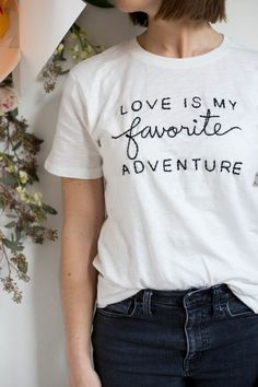 Love is My Favorite Adventure Tee : I had the opportunity to put my feelings about love on a tee shirt Valentines Day. This is what I came up with: Love is My Favorite Adventure. Cute Tshirts, Tee Shirts, Embroidery T Shirt, Diy Kleidung, White T, T Shirts With Sayings, Printed Shirts, Graphic Tees, Shirt Designs