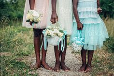 Three flower girls holding flowers outdoors by Gabriel (Gabi) Bucataru for Stocksy United