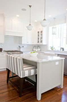 Lovely white Kitchen but what really stuns is the central console with double sofa stools in taupe stripe - giant design step forward for the world of stools . . .