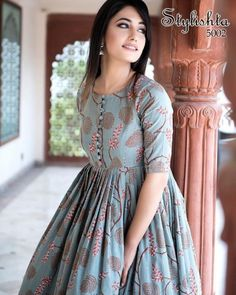 Beautiful Kurtis Online : Stylish and Trendy Kurti for Women - Light Steel Blue Muslin Printed Anarkali Long Kurti Source by sareecom_india - Simple Kurti Designs, Kurta Designs Women, Simple Frock Design, Latest Kurti Designs, Long Dress Design, Sleeves Designs For Dresses, Dress Neck Designs, Kurti Back Neck Designs, Designer Kurtis