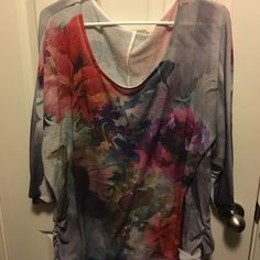 Floral graphic print tee Lane Bryant. Floral graphic print tee. 3/4 sleeves. Side ruching. Worn 2 times. No tags. Lane Bryant Tops Tees - Long Sleeve