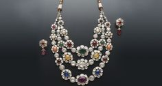Necklace & earrings in 18k yellow gold, diamonds & navaratna stones. (Nine gem stones)