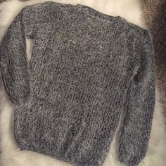 Fluffy Gray Sweater Great loose fitting fluffy sweater in gray. Size medium but a small could wear as well just for a looser fitting look! Sweaters