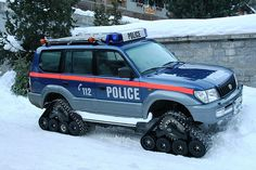 The ultimate snow police vehicle. Basically an SUV with tank-like wheels.