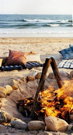 Dig down into sand for beach fire that wont get blown out by wind. Cover with sand to put fire out.