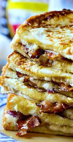Bacon Stuffed French Toast- sub low carb French toast Bacon is stuffed between 2 pieces of bread lathered with a cream cheese/brown sugar mixture. The ultimate sweet and salty breakfast! Breakfast Appetizers, Breakfast Desayunos, Breakfast Dishes, Breakfast Casserole, Stuffed French Toast Casserole, Yummy Breakfast Ideas, Mexican Breakfast, Breakfast Sandwiches, Breakfast Food Recipes