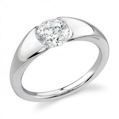 Looking for a low profile engagement ring? Consider Stardust Designs, available at Emma Parker & Co.