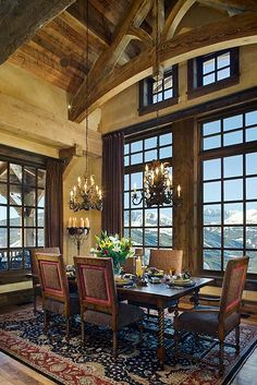 Cedarview residence in Yellowstone Club by Locati Interiors in Montana.  Wood ceiling, chandeliers, mountain view, timber beams, ski lodge, mountain home.