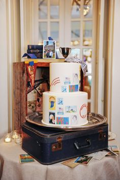 Vintage stamps were reproduced on this wedding cake, and an antique suitcase was used as a cake stand to produce a vintage feel.     Love It? Get It!Design Cuisine