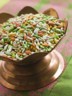 Often placed near the exit of an Indian restaurant is a tray of small colored candy - coated fennel seeds. They have a sweet, almost licorice like taste. Chewing fennel seeds after meals is common in India. Benefits Of Fennel, Health Benefits, Cooking Fennel, Dinner Mints, Fennel Seeds, Indian Sweets, Healthy Alternatives, Ayurveda, Indian Food Recipes