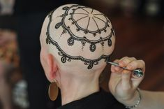 "Henna Heals | a new Toronto team of artists whose exquisite, hand-painted ""henna crowns"" turn the bald heads of women who have lost their hair to chemotherapy into inspiring works of art."