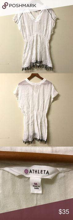 Athleta Swim Cover Up White Athleta swimsuit cover-up with black trim and fringes. Size Medium. MINT condition, no flaws whatsoever. Looks like new! Athleta Swim Coverups