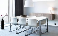 TORSBY table in white glass/chrome-plated seats 4 and BERNHARD white leather chairs with chrome legs. ikea