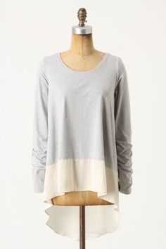 Start with McCall's 6205 view C. Sew the main top in a lightweight knit and add a contrast band in a lightweight silk or linen.   This Anthropologie top has set in sleeves and the pattern has raglan sleeves, but it will cost much less than $68 to sew your own Add a
