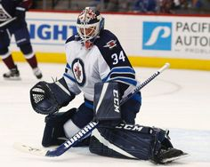 Winnipeg Jets goalie Michael Hutchinson makes a save with his skate on a shot from a Colorado Avalanche player during the third period of an NHL hockey game Friday, Oct. 28, 2016, in Denver. The Jets won 1-0. (AP Photo/David Zalubowski)