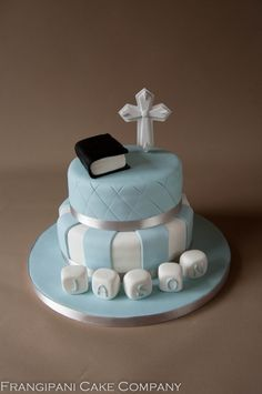 A cute 2 tier sponge cake for a recent christening. The sponge was vanilla with a butter cream filling, which was covered in baby blue sugar paste, decorated with a sugar paste bible and cross.