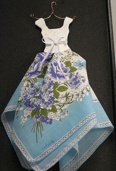 hanky dress - cute for a little girls room or maybe a magnet for the fridge?  Just another cute way to display
