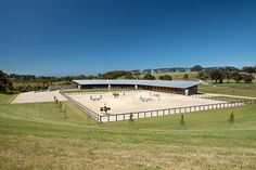 Merricks Stables.  Corrugated Steel Water Tanks channel water to large water tanks under the paddock.....overflow supplies lake...