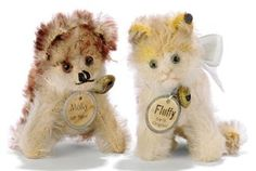 A STEIFF TINY SEATED FLUFFY, (3307), grey tipped golden mohair, green and black glass eyes, pink stitching, whiskers, ribbon with bell, FF button and card chest tag with metal rim, circa 1927 --2½in. (6.5cm.) high (some fading); and a tiny seated Molly, (3307), brown tipped and white mohair, brown and black glass eyes, black stitching, remains of ribbon with bell, FF button and chest tag with metal rim, circa 1928 --2½in. (6.5cm.) high (slight thinning)  (2)