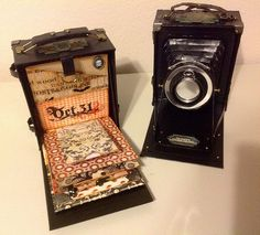 Camera Box - Back opened up to show a mini album - By Lynnie Frucci, PickaPepPeR (Flickr) Awesome!