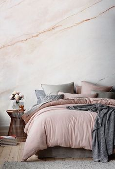 This subtle yet chic blush pink fade marble wallpaper will give everyone major wall envy.