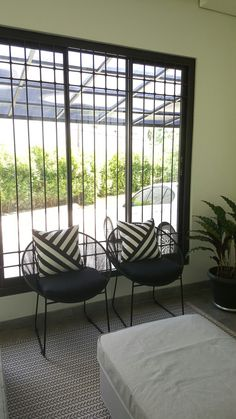 Synthetic rattan Louis chairs.