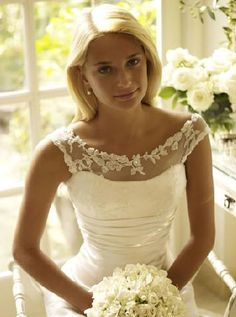 the neckline is so pretty http://apparelsdepot.com/product-category/woman-collection/wedding-dress/