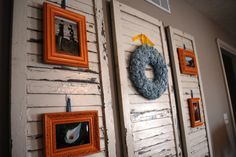 Creative way to hang picture frames using old wood shutters.